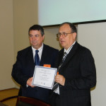 6. Professors Theodor Valentin Purcarea and Virgil Popa when handingreceiving Diploma of Special Merit.3