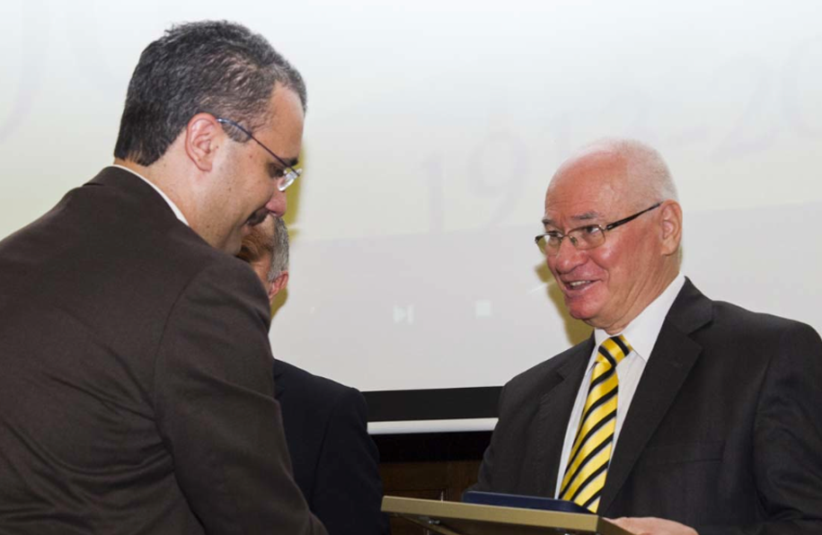 Ovidiu FOLCUȚ receiving Diploma of Excellence from Gheorghe ZAMAN