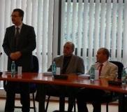Professor Ovidiu Folcut, Rector of the Romanian American-University, and  Professors Kent Zimmerman and Bijan Saadatmand, James Madison University