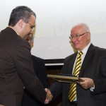 RAU Rector Ovidiu FOLCUȚ receiving Diploma of  Excellence from Professor Gheorghe ZAMAN